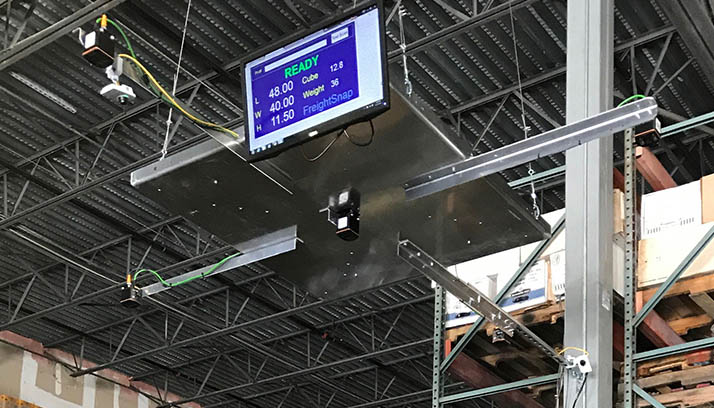 FreightSnap's FS 5000 pallet dimensioner showing pallet measurements on the display screen.