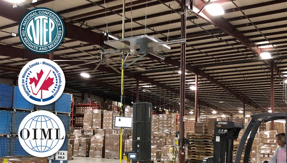 FreightSnap's FS 5000 pallet dimensioner installed at a shipper's warehouse. NTEP, Measurement Canada, and OIML certification logos are also pictured.